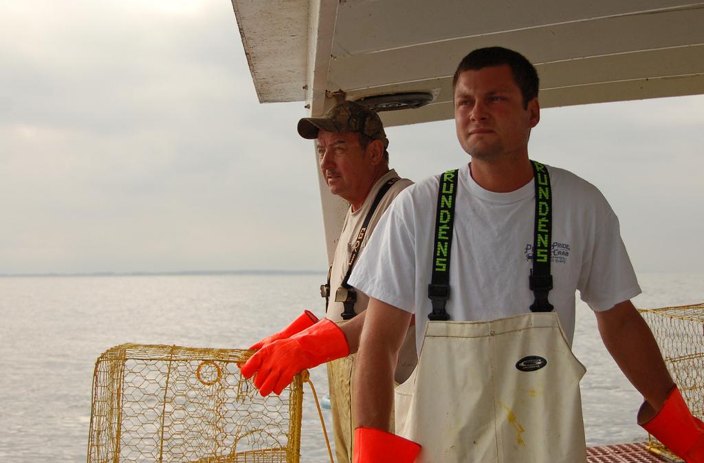 Chesapeake Bay watermen Patrick Mahoney Jr. and Patrick Mahoney Sr., photo by multimedia journalist and environment reporter Pamela Wood.