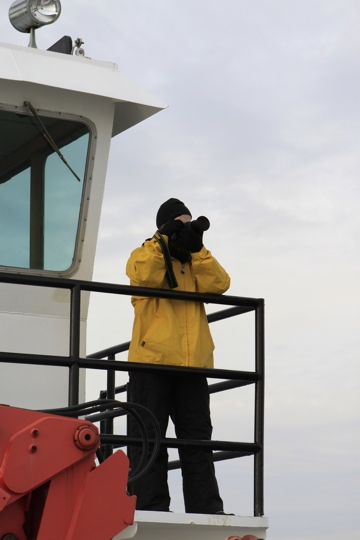 Photo of multimedia journalist and environment reporter Pamela Wood aboard a Chesapeake Bay icebreaker.