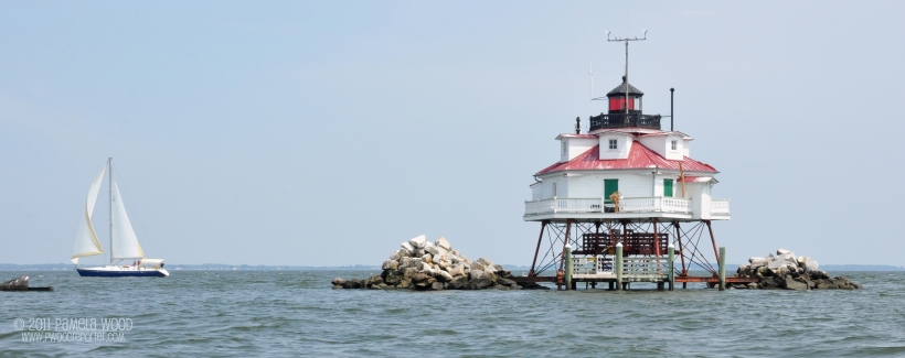 Sailboat passes by the Thomas Point Shoal Lighthouse in the Chesapeake Bay, photo by multimedia journalist and environment reporter Pamela Wood.