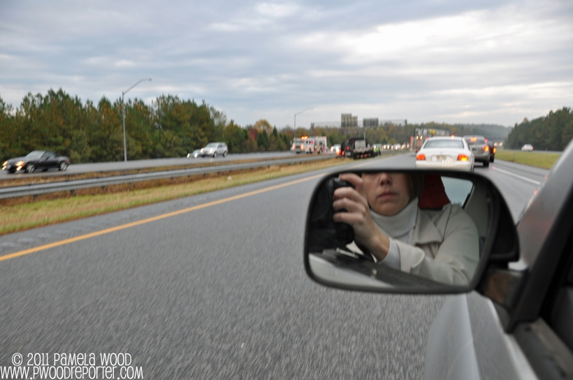 Accidental self-portrait while shooting a highway wreck, photo by multimedia journalist and environment reporter Pamela Wood.